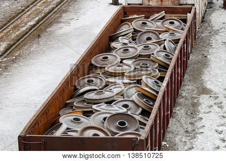 Gondola rail car full of new rail wheels