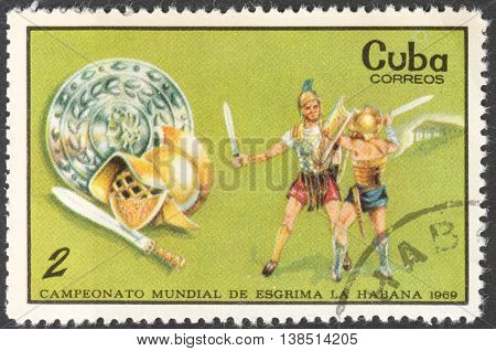 MOSCOW RUSSIA - CIRCA FEBRUARY 2016: a post stamp printed in CUBA shows gladiators the series