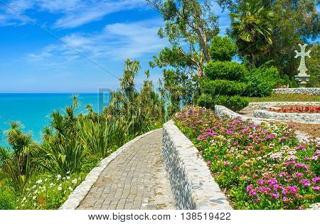 The picturesque viewpoint in Batumi Botanical Garden overlooks the bright blue waters of Black Sea with the yucca thickets on the Georgia.