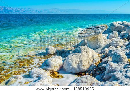 The Dead Sea is the natural border between Jordan to the east and Israel and Palestine to the west Ein Gedi Israel.