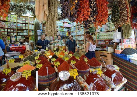ISTANBUL - AUGUST 9: Unknown man trades spices in an Egyptian Bazaar, August 9, 2013 in Istanbul, Turkey. Egyptian Bazaar (Spice Market) one of the most popular tourist attractions in Istanbul