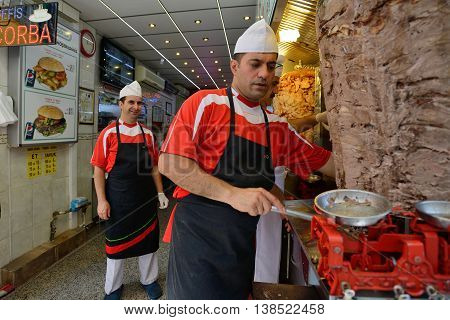 ISTANBUL - AUGUST 9: Unknown man cooks and sells traditional kebab in a small buffet, August 9, 2013 in Istanbul, Turkey. Istanbul is the world's fifth-most-popular tourist destination.
