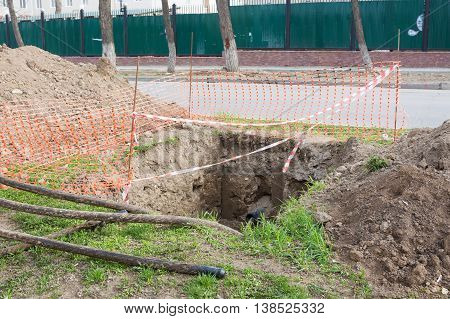 Dug Pit Fenced For Replacing Electric Cables Underground