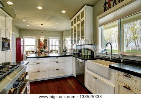 Empty Simple Old Kitchen With Hardwood Floor And White Cabinets