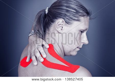 a woman with medical taping on grey
