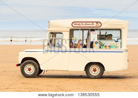 WHITBY ENGLAND - JULY 12: Woman with children making a purchase from 'Whitby Ice Cream Co' ice cream van on the beach. In Whitby North Yorkshire England. On 12th July 2016.