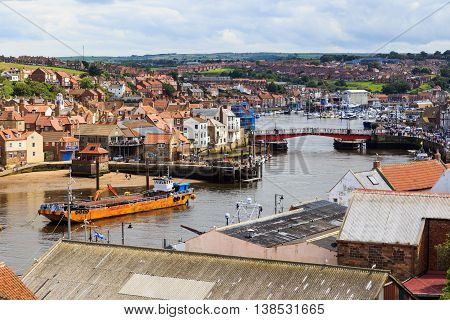 WHITBY ENGLAND - JULY 12: High viewpoint of Whitby showing the swing-bridge and town. In Whitby North Yorkshire England. On 12th July 2016.