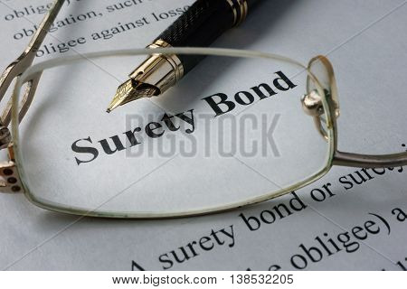 Page of newspaper with words surety bond. poster