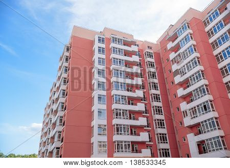 modern new apartment building on blue sky background