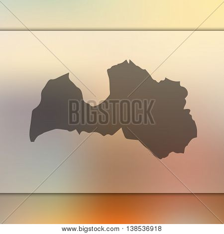 Latvia map on blurred background. Blurred background with silhouette of Latvia. Latvia. Latvia map.