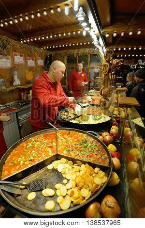 BERLIN - NOVEMBER 23: Unidentified people trades food in annual traditional Christmas fair in Potsdamer Platz (Potsdam Square) on 23 November 2013 in Berlin, Germany.