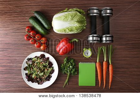 Workout and fitness dieting concept. Fitness equipment and healthy food