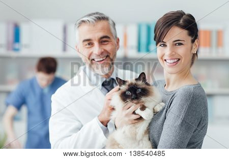 A Woman With Her Cat At The Veterinary Clinic