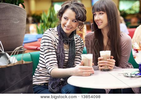 Friends having lunch at a cafe laughing and smiling