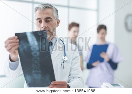 Radiologist Examining A Patient's X-ray