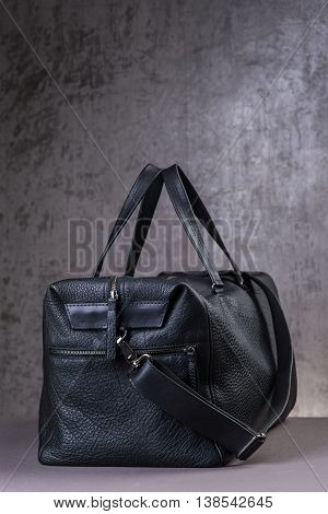 Black Leather Traveling Bag, Over The Concrete Wall Background