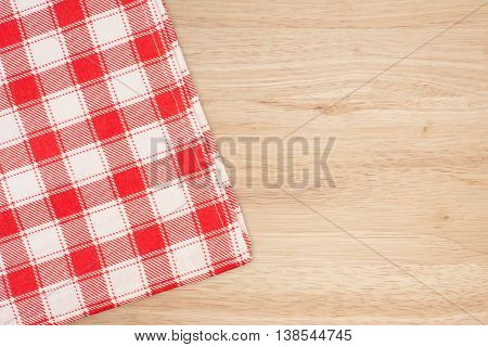 the checkered tablecloth on wooden table. the checkered tablecloth on wooden table.