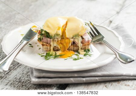 Eggs Benedict In The Context Of A Hollandaise Sauce