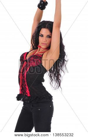 Sexy brunette in a red corset with her hands up poster