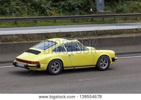 FRANKFURT GERMANY - JULY 12 2016: Old Porsche 911 sportscar driving on the highway in Germany
