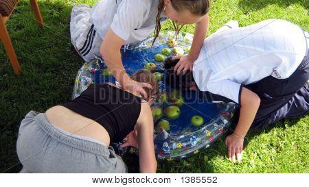 Girls Playing Apple Bobbing