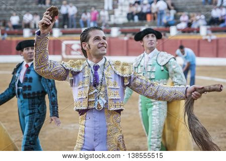 Andujar SPAIN - September 10 2011: The Spanish Bullfighter David Valiente to the turning of honour with an ear in his hand Andujar Spain