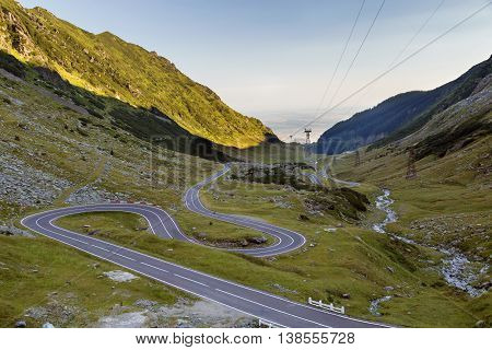 Mountain road at sunrise. Summer landscape of Transfagarasan highway