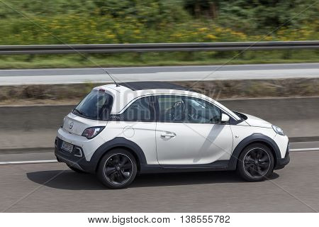 FRANKFURT GERMANY - JULY 12 2016: Opel Adam Rocks mini crossover driving on the highway in Germany