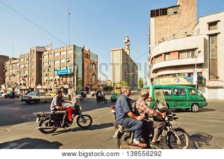 TEHRAN, IRAN - OCTOBER 6, 2014: City traffic with many bikes on busy street of iranian capital on October 6, 2014. With a population of 8.3 million Tehran is 32nd national capital of Iran