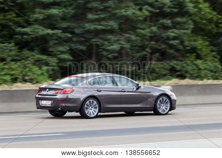FRANKFURT GERMANY - JULY 12 2016: BMW 6 Series 4 door coupe driving on the highway in Germany