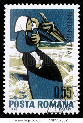ZAGREB, CROATIA - JUNE 19: a stamp printed in Romania shows Mother with child and destroyed house, Plight of the Danube flood victims, circa 1970, on June 19, 2012, Zagreb, Croatia