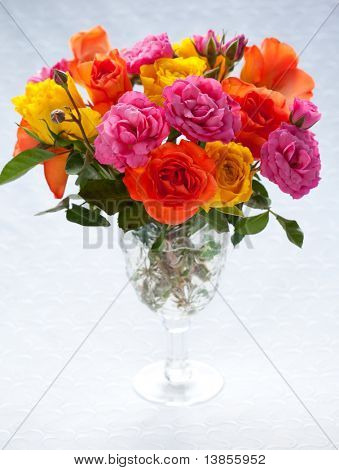 bouquet  of multi-colored roses in vase