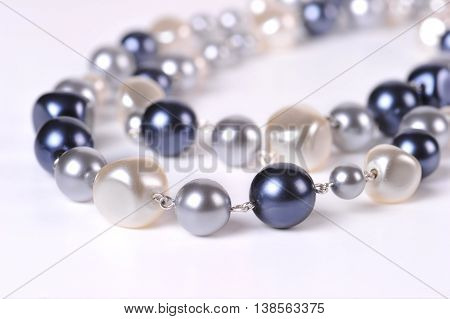 Pearl beads close-up on a white background