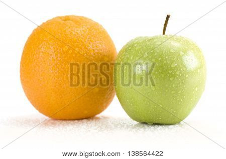 Fresh apple and orange isolated on white background