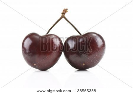 Two cherries isolated on a white background
