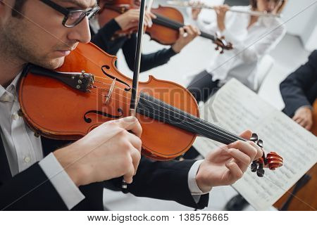 Violinist Performing With Music Sheet