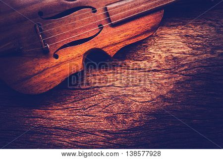 Violin on grunge dark old wood background