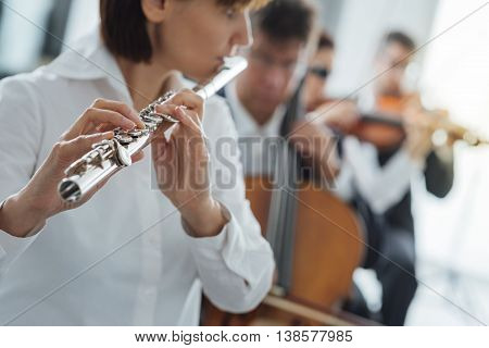 Flutist Playing Her Instrument On Stage