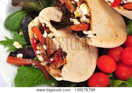 Pitta bread on salad leaves filled with a chicken