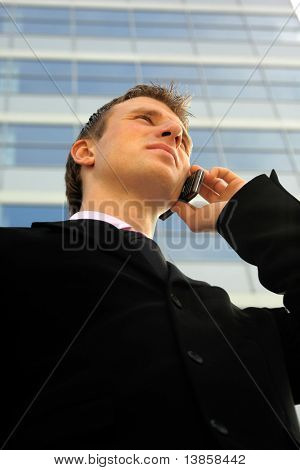 Young businessman calling on mobile phone, outdoor