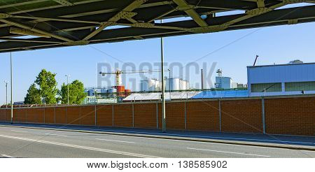 industry park from roadside with railway bridge