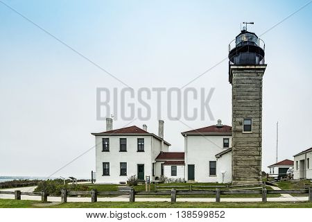View of the Beavertail Light lighthouse near Jamestown on Conanicut Island, Rhode Island, with a bright blue sky