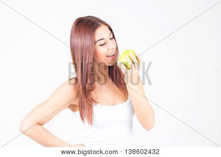 Beautiful woman bites green apple. Healthy lifestyle.