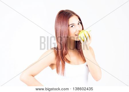 Happy smilling woman bites apple. Healthy lifestyle.
