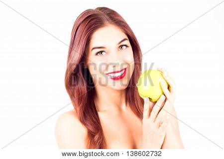 Smiling woman with red lips holding a green apple.