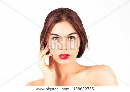 Beautiful woman with red lips touching cheek. Make up with red lips.