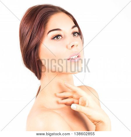 Gorgeous and elegant woman with a beautiful and clean skin touching neck. SPA and beauty treatment.