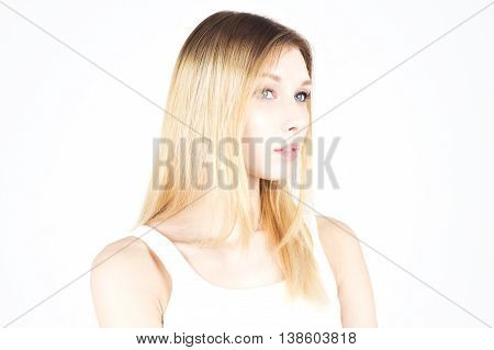 Beautiful blonde with colored hair on a white background. Hairdressing.