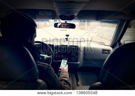 Dangerous driving while writing SMS text message
