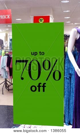 Sale Sign. Up To 70% Off. Store Lights.